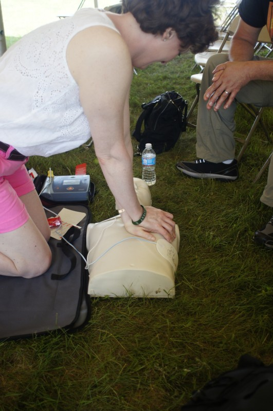 Practicing CPR skills in Fr33 Aid's workshop at Porcfest X