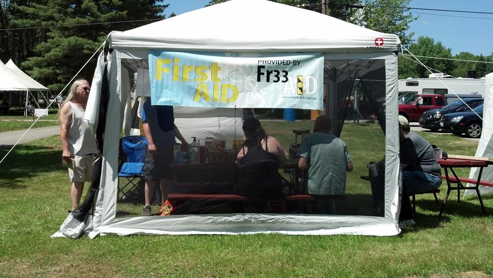 Gathering at the Fr33 Aid booth