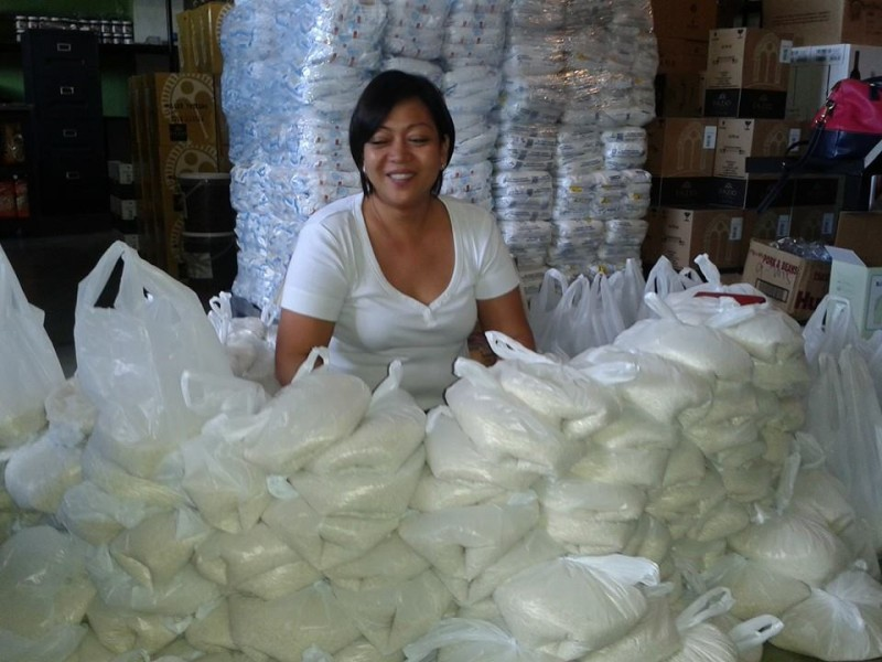 Surrounded by rice bags. Photo by Raffy Ruiz.
