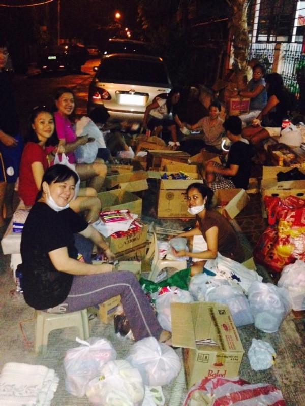 Packing food in the dark. Photo by Mai Ilagan.